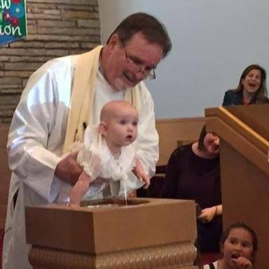 Pastor Jim performing a Baptism